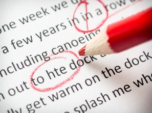 Proofreading red pencil with various errors on paper