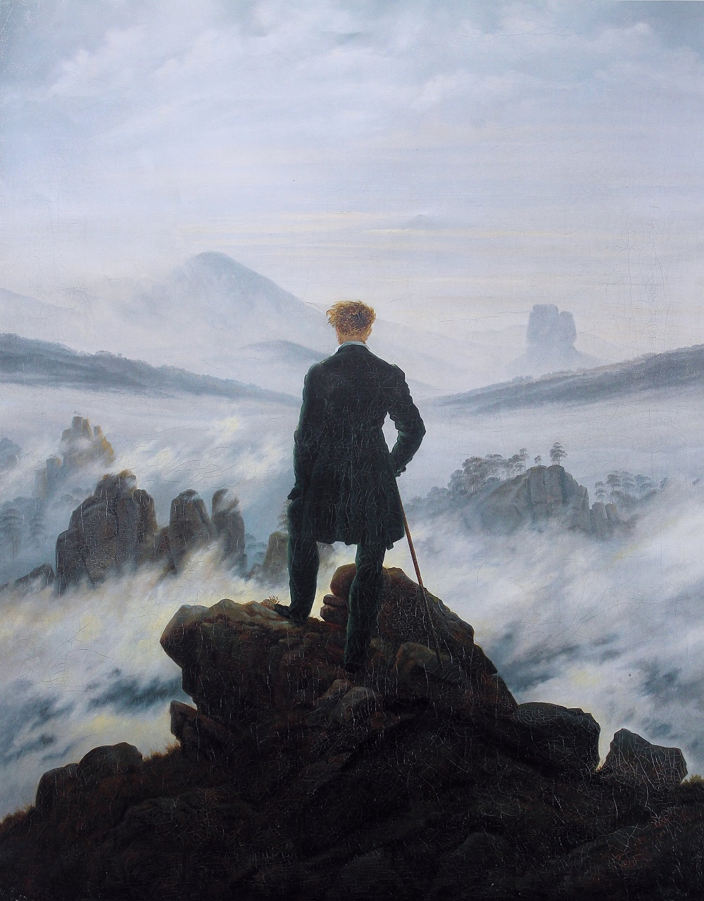 Man at the top of a mountain looking out
